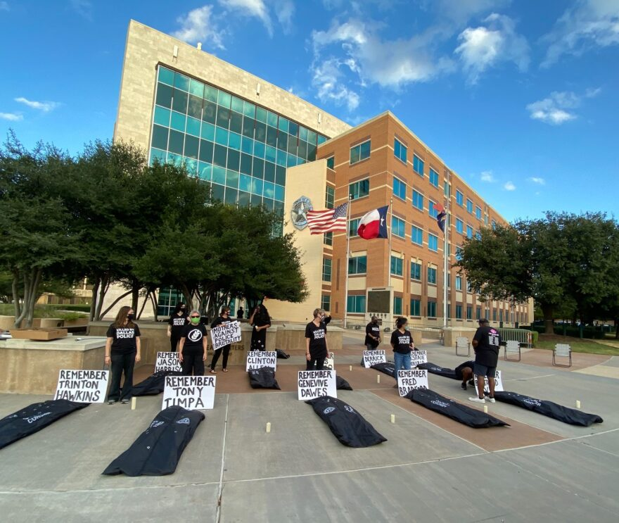 Mothers Against Police Brutality stage a silent vigil in front of Dallas Police Headquarters to draw attention to those killed by police.
