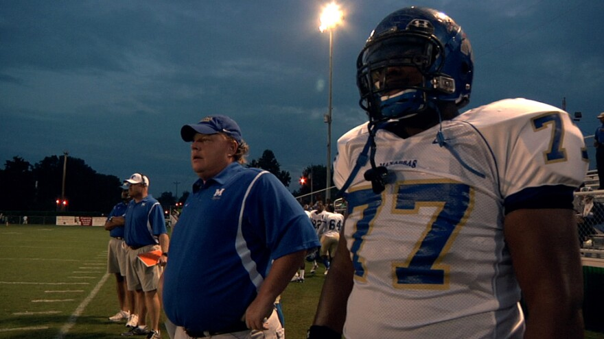 North Memphis' Manassas Tigers Coach Bill Courtney and player O.C. Brown stand on the sidelines in a scene from the Oscar-nominated documentary <em>Undefeated</em>.