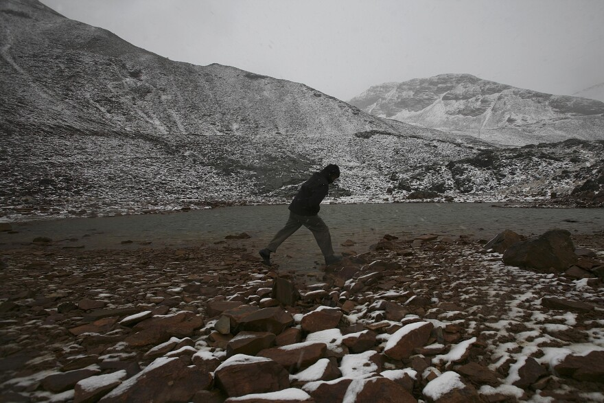A man walks on Glacier Chacaltaya in the Andes mountains in Bolivia on Oct. 24, 2009. Glacier Chacaltaya was famous for being the world's highest ski run but since the mid-'90s has not had enough snow for skiing.