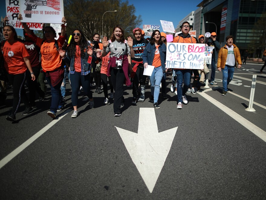High school students march from the White House to the U.S. Capitol to call for stricter gun laws on Friday in Washington, D.C.
