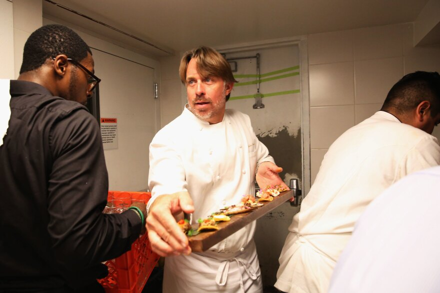 John Besh prepares food at an event in New York City in 2014. After he was accused of sexual harassment a year ago his national fame became a liability for the Besh Restaurant Group.