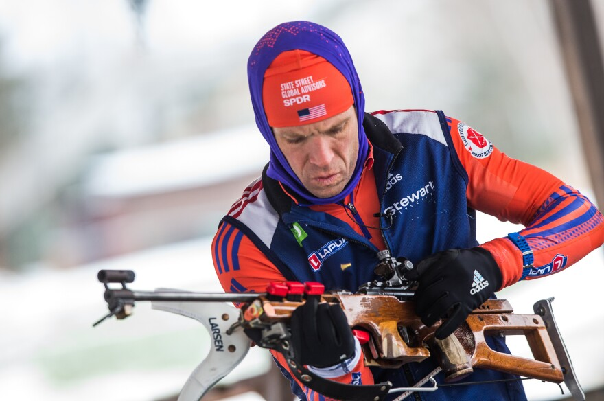 U.S. biathlete Lowell Bailey prepares his rifle before target practice in Lake Placid, N.Y.