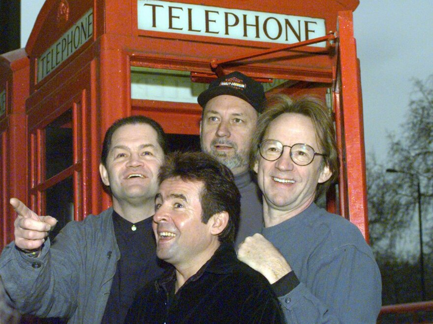 The Monkees (from left: Micky Dolenz, Davy Jones, Mike Nesmith and Peter Tork) pose in front of a London telephone booth in 1997.