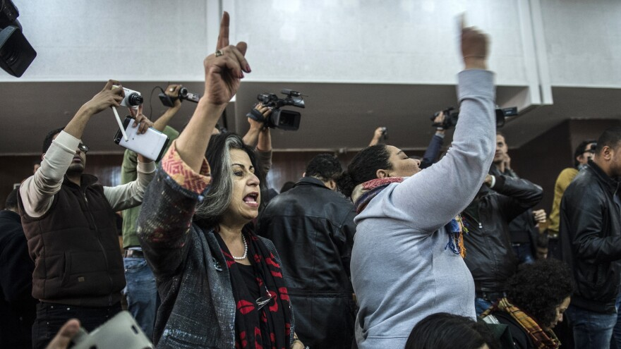 Relatives and supporters of Egyptian activist Alaa Abdel Fattah react after Monday's verdict in a trial over an illegal protest.