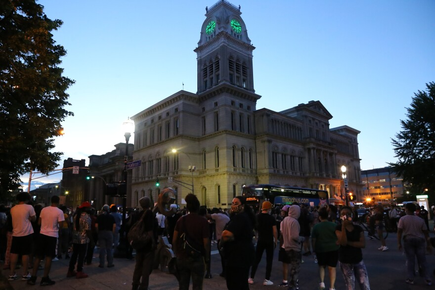 Protesters begin to gather outside City Hall in Louisville, Ky., on Thursday. The crowds formed not long after the release of a 911 call from Breonna Taylor's boyfriend on the night she died.