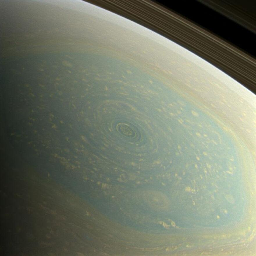 "A huge storm is seen on Saturn's north pole, in this color image from NASA's Cassini spacecraft. NASA used red, green and blue spectral filters ""to create this natural-color view, which is what the human eye would see if we were there at Saturn."""