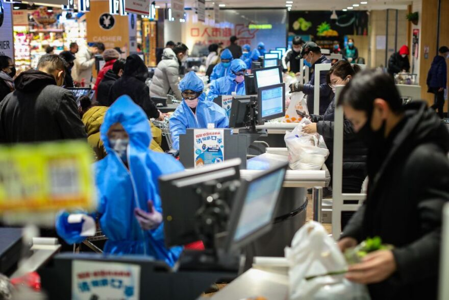 People wearing protective masks shopping at a super market in Shenyang in China's northeastern Liaoning province. (AFP via Getty)