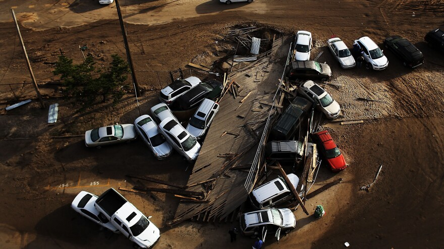 Abandoned and flooded cars sit in the Rockaway neighborhood of Queens, N.Y., on Nov. 2. It's estimated that it could cost auto insurers $800 million to deal with all the claims from the storm.