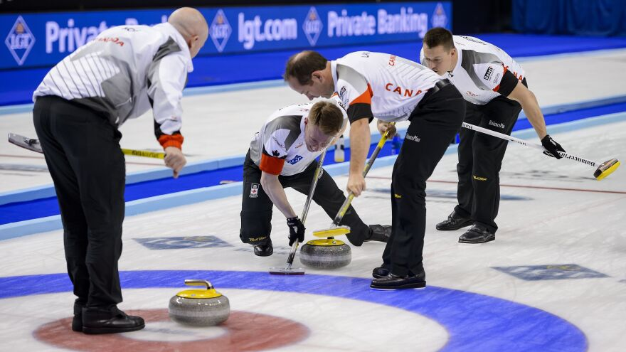 (From L) Canada's team: skip Kevin Koe, third Marc Kennedy, second Brent Laing and lead Ben Hebert compete at the World Men's Curling Championships on April 10, 2016 in Basel, Switzerland.