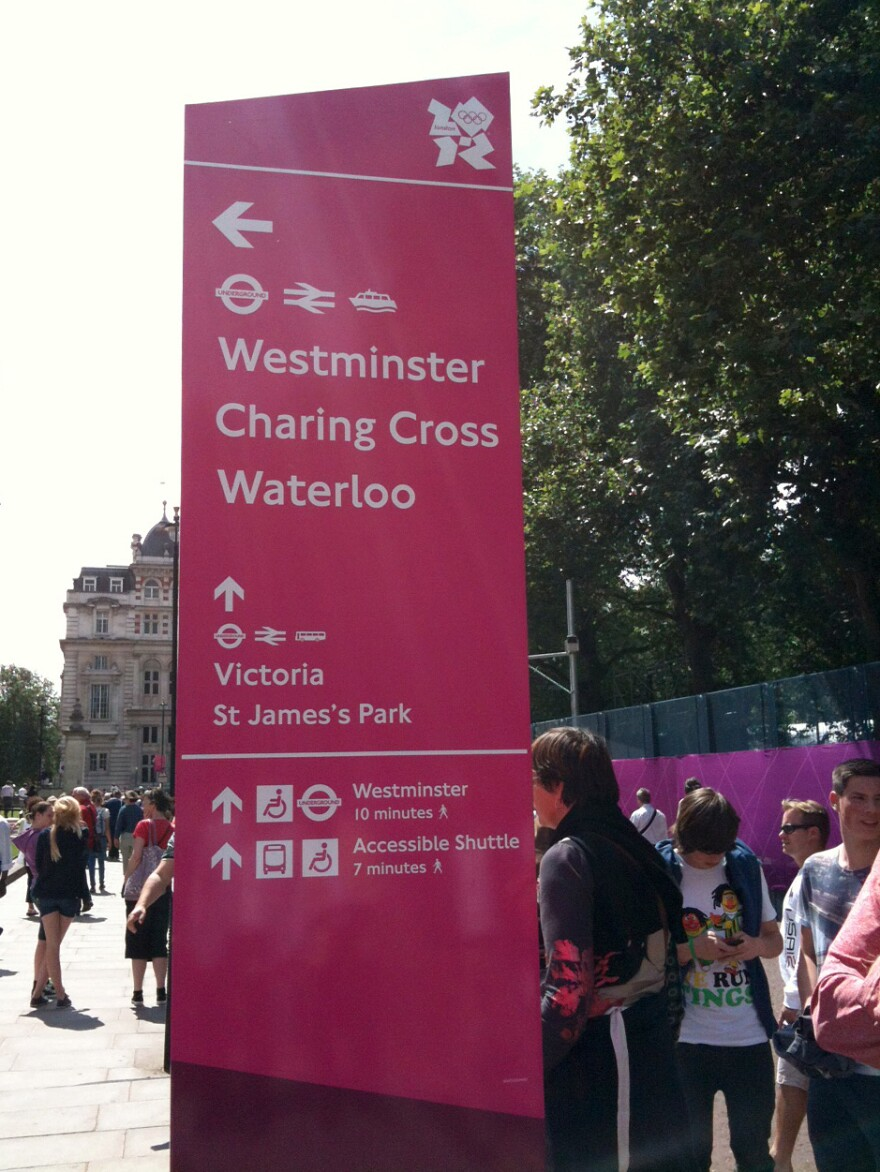 Signs for London's Underground train system were updated with icons to help Olympic visitors find events.