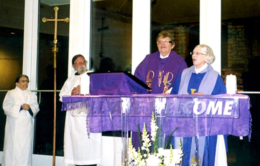 """Elsie McGrath, right, and Rose Marie """"Ree"""" Hudson, center, hold the first Mass at Therese of Divine Peace on December 1, 2007."""