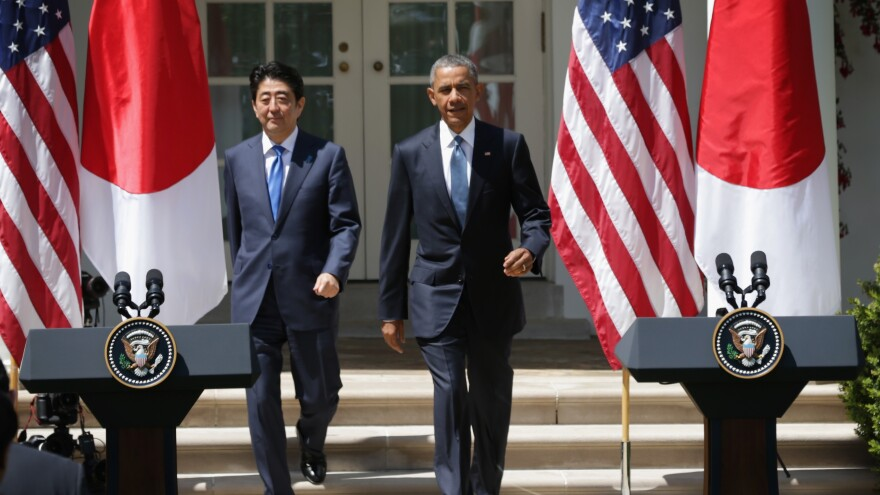 President Obama and Japanese Prime Minister Shinzo Abe approach the podiums for a joint press conference Tuesday at the Rose Garden of the White House in Washington. President Obama is hoping to finalize a new trade agreement with Japan and other Asian nations soon.