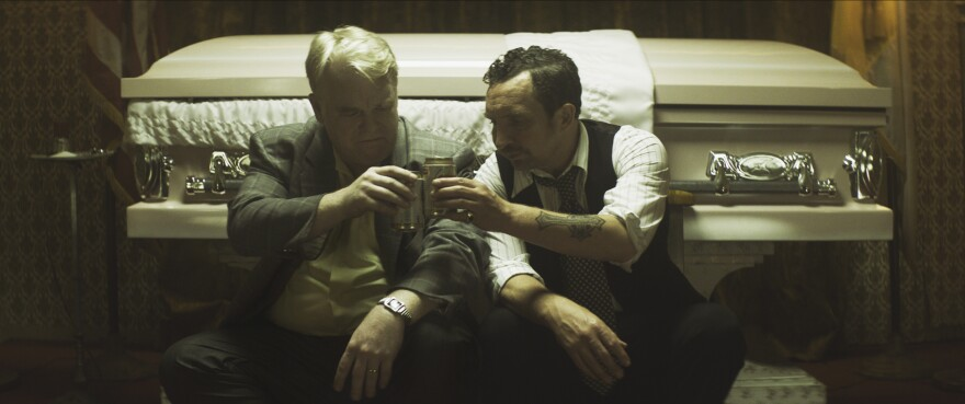 Philip Seymour Hoffman (left) and Eddie Marsan, in a scene from the film, <em>God's Pocket.</em>