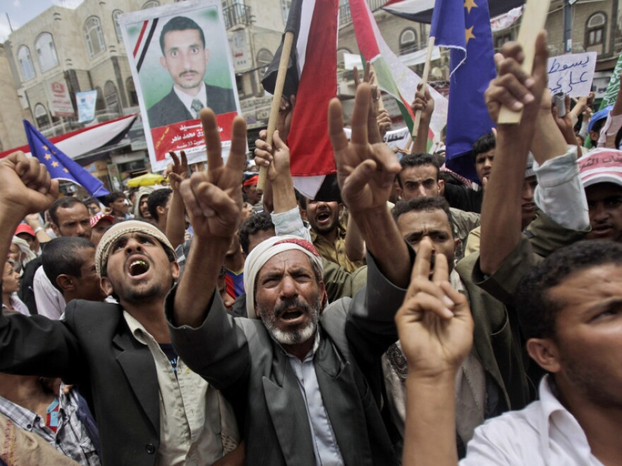 Global economic meetings in Washington, D.C., this week take place as protesters, like these in Sanaa, Yemen, demonstrate for the overthrow of governments and measures to address poverty.