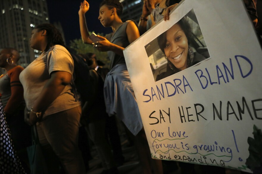 A demonstrator holds a Sandra Bland sign during a vigil in July 2015 in Chicago.