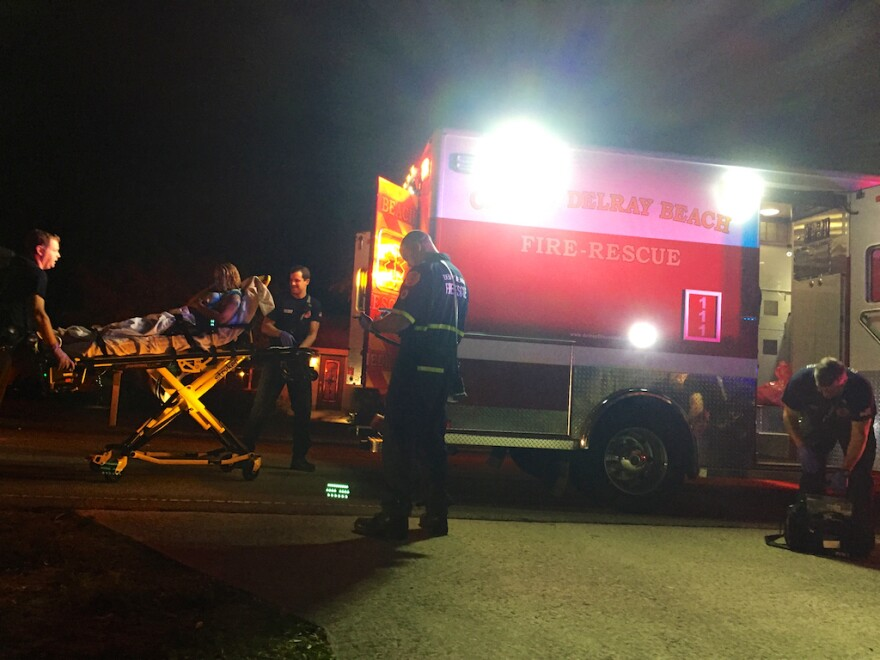 Delray Beach Fire Rescue personnel treat a woman who overdosed at a sober living facility on Nov. 18, 2016.