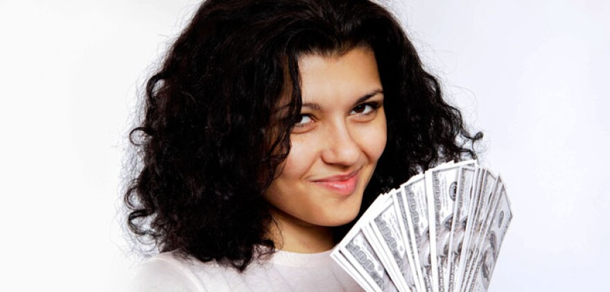 Woman-with-money-by-Tax-Credits-dot-com-Creative-Commons.jpg