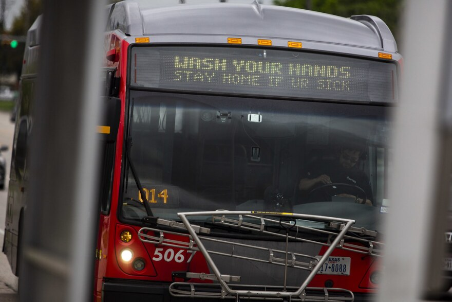 A Capital Metro bus displays a public health message to wash hands.