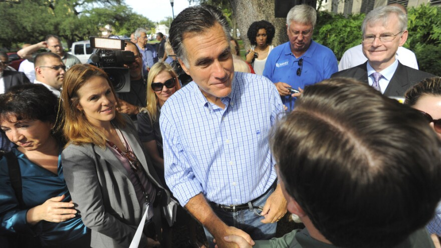 Republican presidential candidate Mitt Romney meets with supporters during the grand opening of his Florida campaign headquarters in Tampa on Friday.