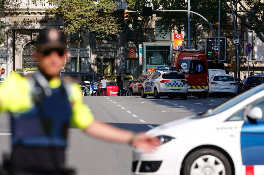 A policeman stand as he blocks the street to a cordoned-off area after a van plowed into a crowd, injuring several persons on the Rambla in Barcelona on Aug. 17, 2017. (Pau Barrena/AFP/Getty Images)