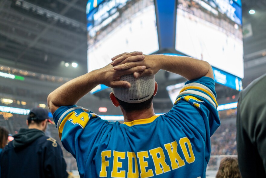 A fan watches the video board at Enterprise Center during Game 7 while wearing a jersey sporting the name of St. Louis Blues great Bernie Federko, who played 13 seasons for the team. June 12, 2019