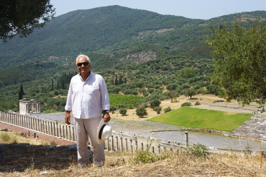Archaeologist Petros Themelis (standing in front of the Doric stadium at Ancient Messene) has excavated at the site since 1986 and is considered a master at private fundraising for antiquities.