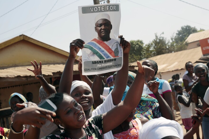 Gambians celebrate the victory of opposition coalition candidate Adama Barrow against longtime President Yahya Jammeh on Friday in the streets of Serrekunda, Gambia.