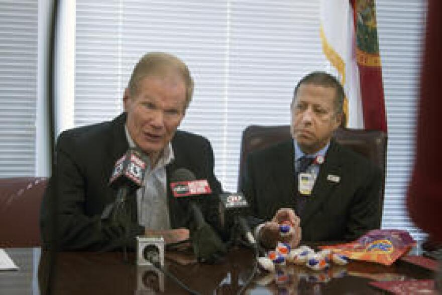 Florida U.S. Democratic Senator Bill Nelson, left, announced Friday, Feb. 13 that he is co-sponsoring a bill to force the Consumer Safety Product Commission to regulate packaging on detergent pods. Doctor Alfred Aleguas, right, said the bright colors and sweet smells attract children too easily.
