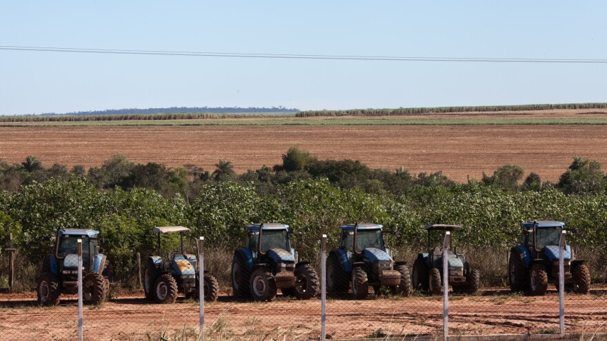 Tractors sit on a sugarcane plantation on the land of a Guarani-kaiowá indigenous community in Brazil.
