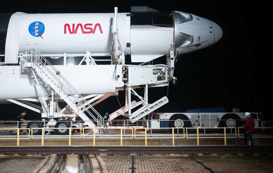 A SpaceX Falcon 9 rocket with the company's Crew Dragon spacecraft onboard is seen on the launch pad at Launch Complex 39A before being raised into a vertical position, Monday, Nov. 9, 2020, at NASA's Kennedy Space Center in Florida. Photo: NASA