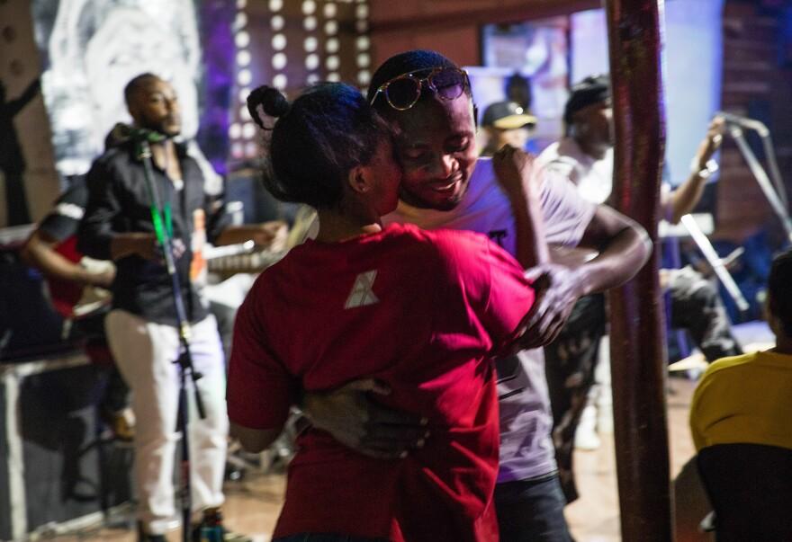 Despite the stress of Ebola, Media Joice Kashamba Emmanuela and her boyfriend, Espoir Kitumaini, dance to rumba music at Ibiza, a dance club in Goma, Democratic Republic of Congo.