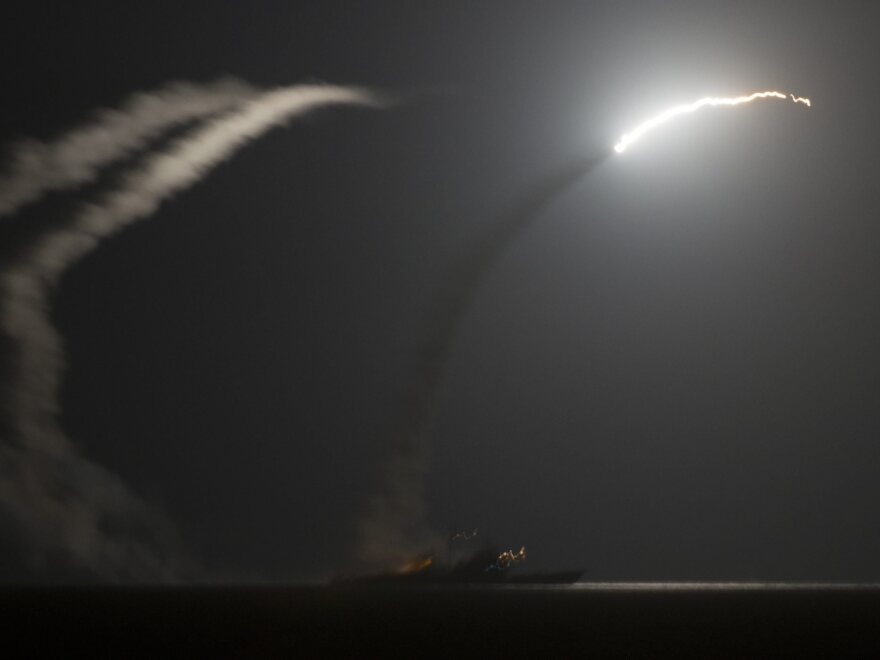 A photo released by the U.S. Navy shows the guided-missile cruiser USS Philippine Sea launching a Tomahawk cruise missile against Islamic State targets in Syria on Tuesday.