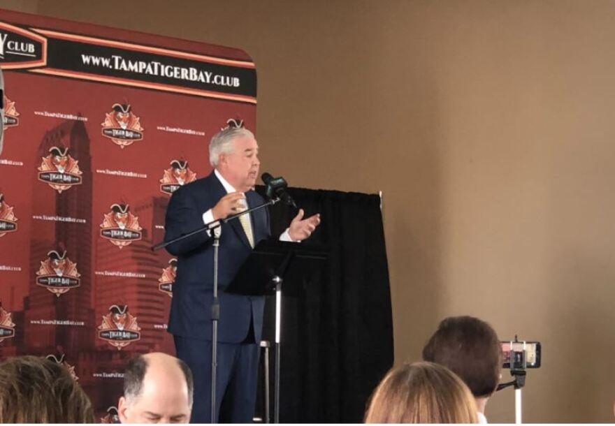 John Morgan speaking at the podium