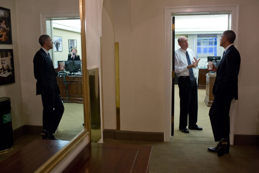 President Barack Obama chats with Neil Eggleston, counsel to the president, outside his office in 2014.