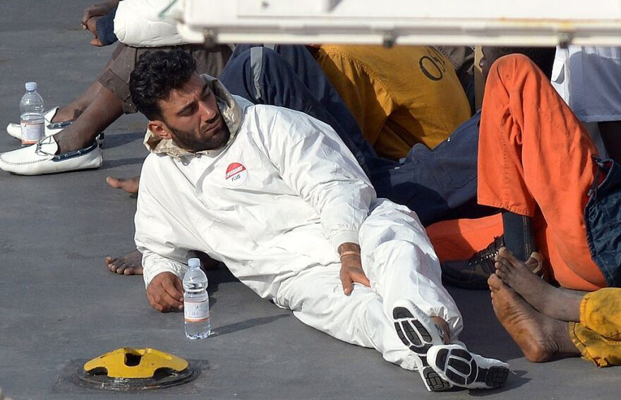 Tunisian national Mohammed Ali Malek, one of the survivors and understood to be the captain of the boat that overturned off the coast of Libya, sits on board the Italian Coast Guard vessel Bruno Gregoretti after he was rescued in April 2015.