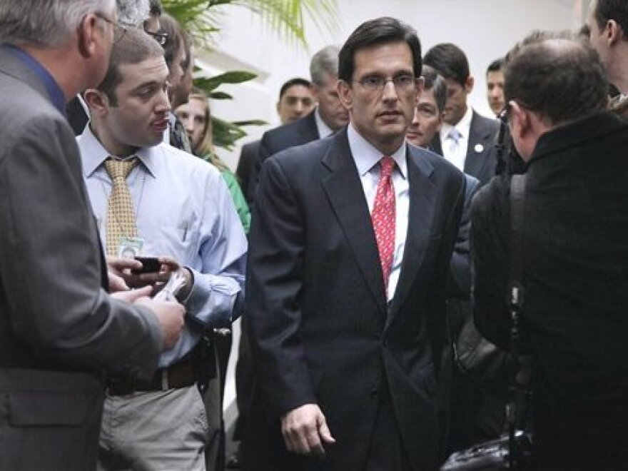 House Majority Leader Rep. Eric Cantor walks to a news conference, April 5, 2011.