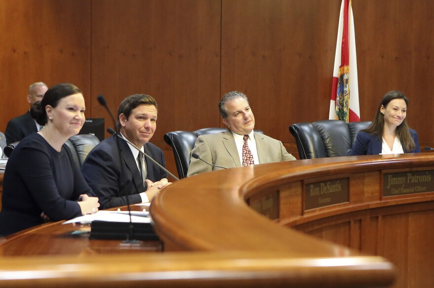 Gov. Ron DeSantis, second from left, presides over the Florida cabinet meeting consisting of Attorney General Ashley Moody, left, Chief Financial Officer Jimmy Patronis, and Commissioner of Agriculture Nikki Fried, far right, Tuesday June 4, 2019.