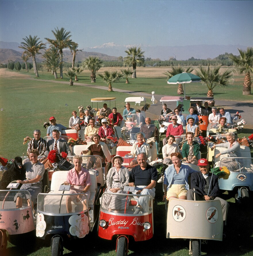 Players pose at the Thunderbird Golf Club, in Palm Springs, Calif., in 1956, when golf carts were first gaining popularity.