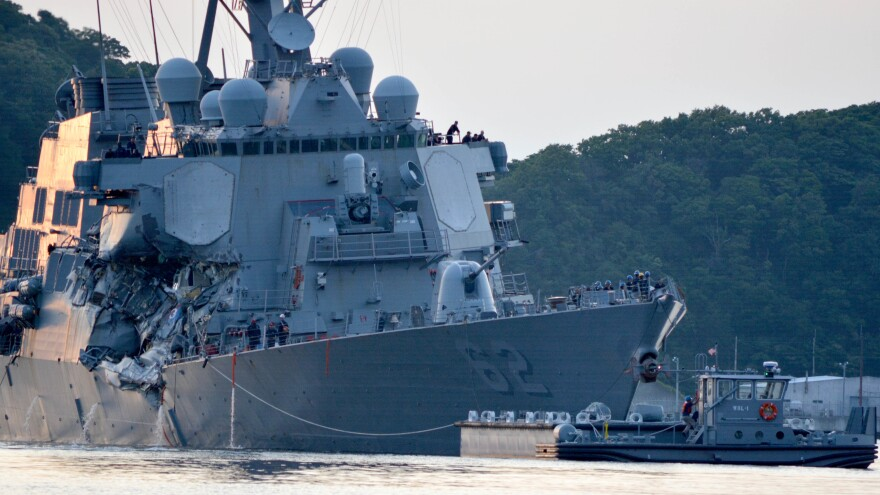 The guided-missile destroyer USS Fitzgerald returns to port after colliding with a merchant vessel in June while operating southwest of Yokosuka, Japan.