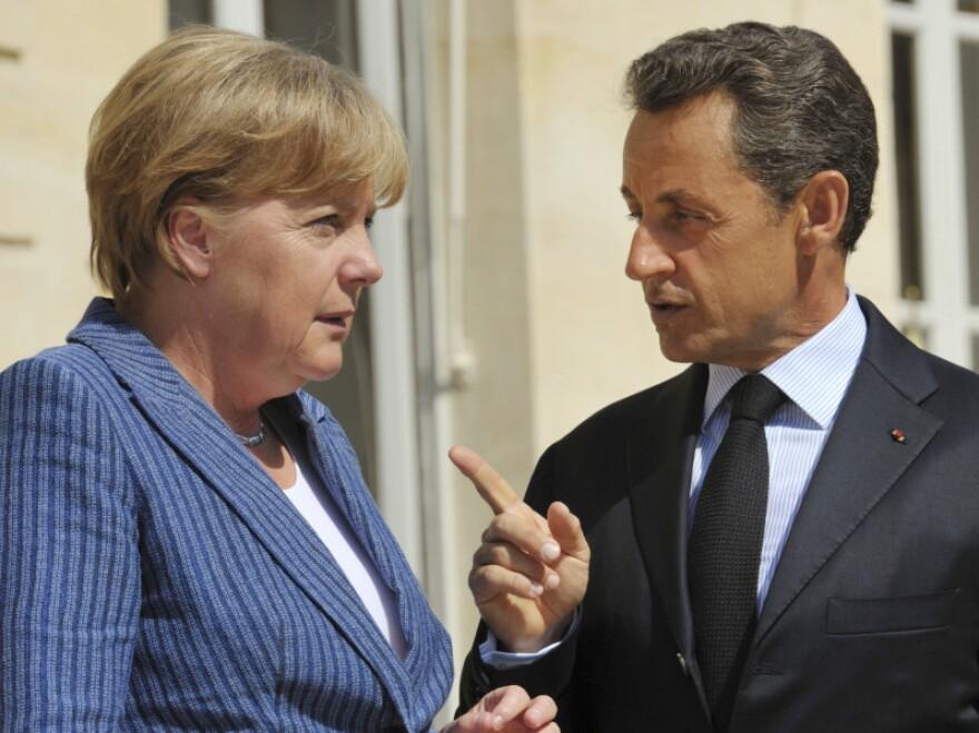 France's President Nicolas Sarkozy, right, speaks to German Chancellor Angela Merkel.