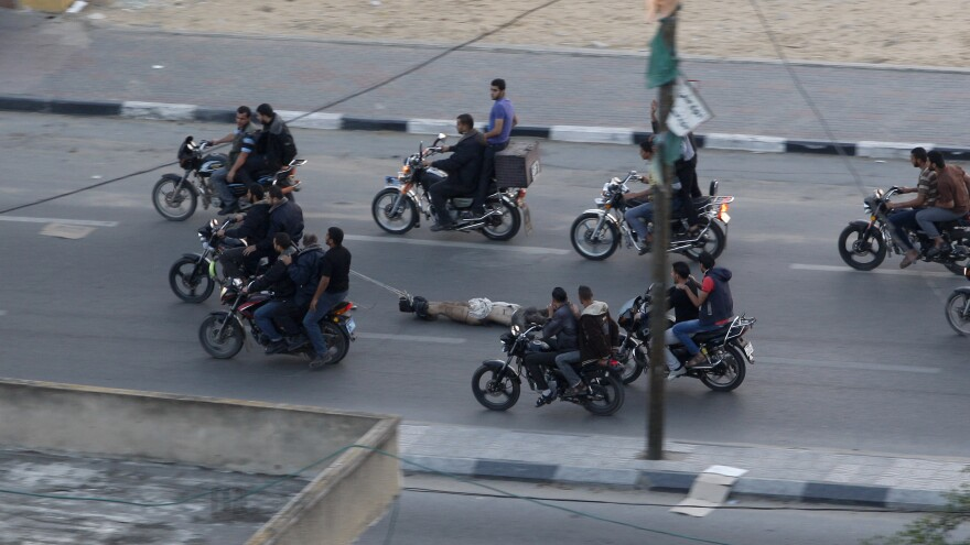 Palestinian gunmen drag a man from a motorcycle in Gaza City on Nov. 20. He was one of six men killed that day on suspicion of collaborating with Israel. The Hamas government in the Gaza Strip denied responsibility, though it has executed others judged to be working with Israel's security forces.