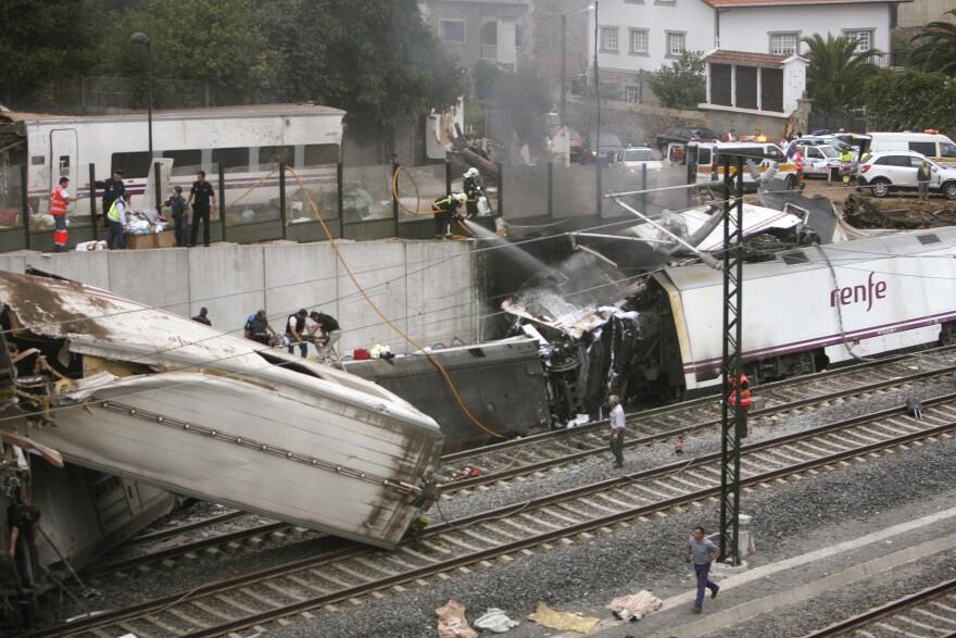 Emergency personnel respond to the scene of a train derailment in Santiago de Compostela, Spain.