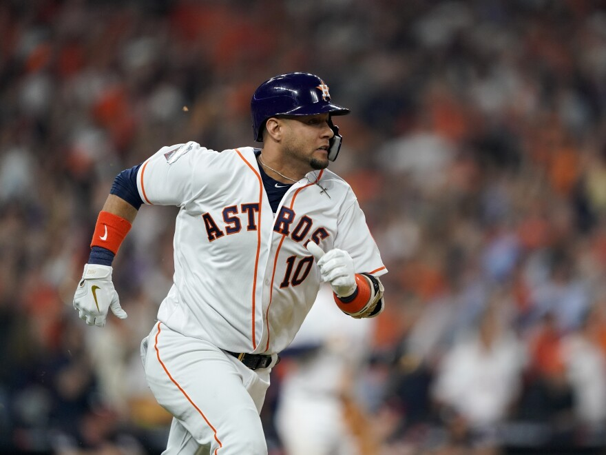 Houston Astros' Yuli Gurriel doubles in the first inning, driving in George Springer and José Altuve.