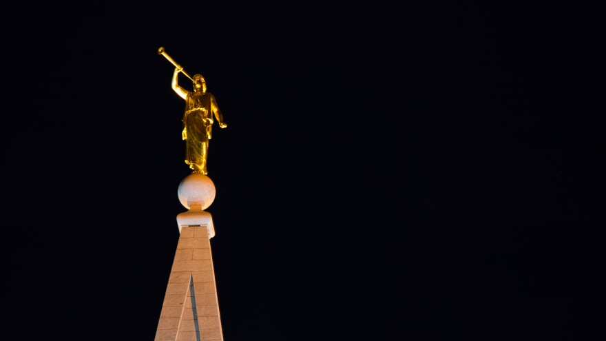 A photo of the Angel Moroni on top of a LDS temple.