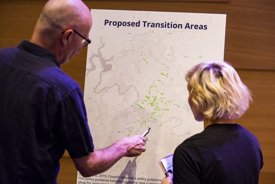 Residents look at a map of transition zones.