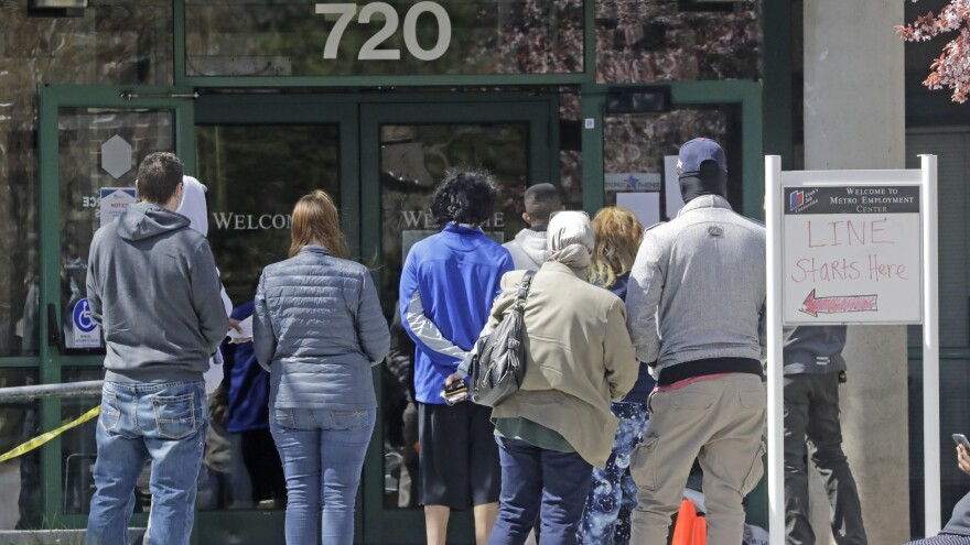 People line up outside the Utah Department of Workforce Services in Salt Lake City on Monday.