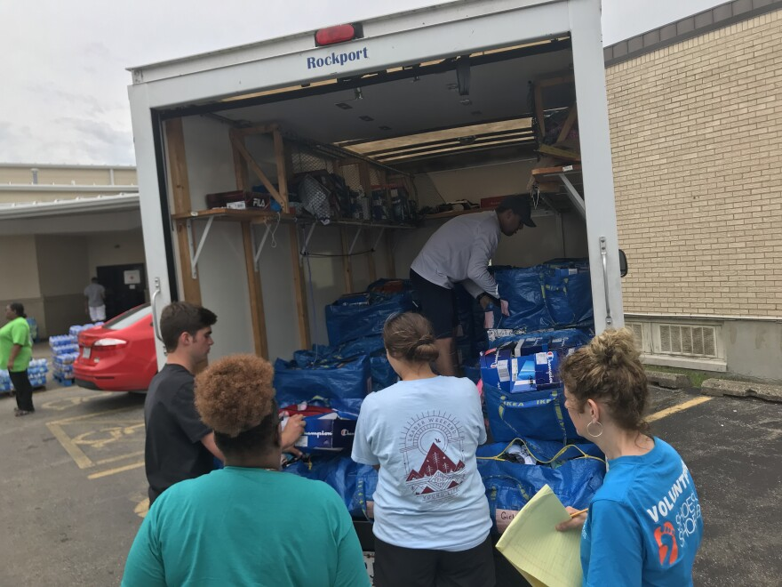 A truckload of shoes arrives at Corinthian Baptist Church, ready for donation to people affected by the recent tornadoes.