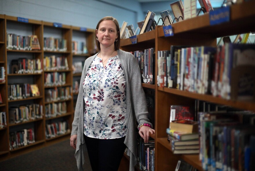 woman librarian standing in library