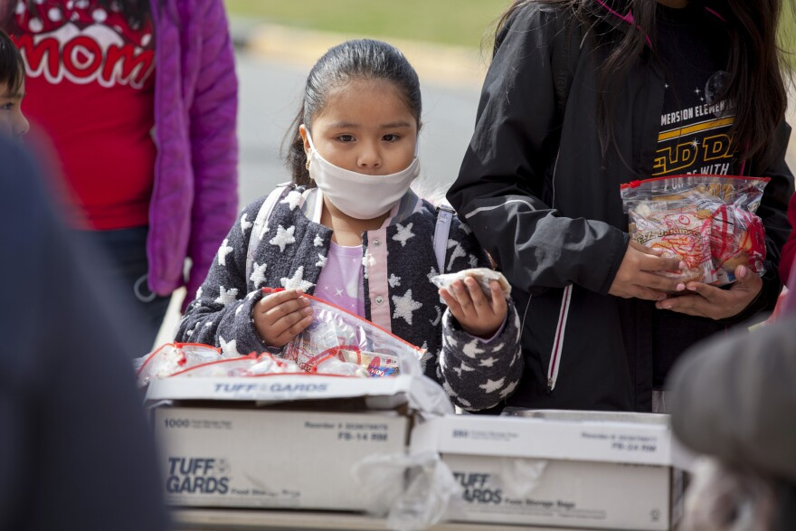 Grab-and-go breakfasts and lunches were handed out to children 2 to 18 years old at a middle school in Arlington, Va.