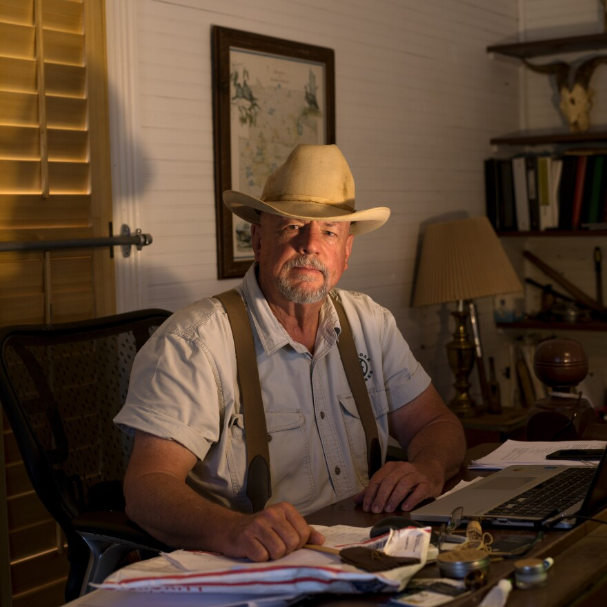 Will Harris, a fourth-generation cattleman and the owner of White Oak Pastures, sits in his office in downtown Bluffton, Ga. In earlier times, Harris sold fertilizers and pesticides. Today, he practices regenerative land management, restoring cycles of nature to land degraded by industrialized processes.